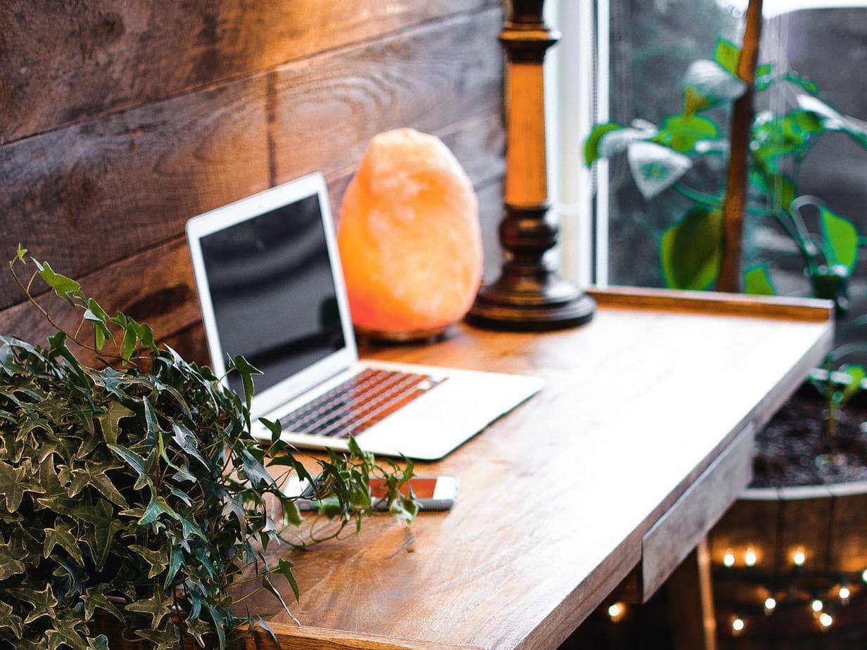 himalayan-salt-lamp-near-laptop-on-wooden-table-3653849 (1)